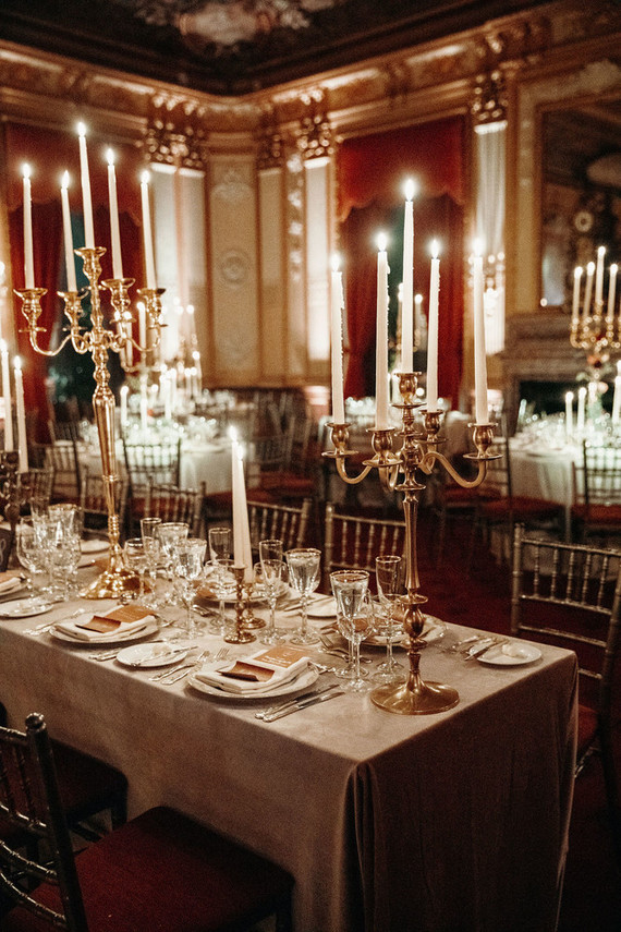The wedding tablescape was done with metallic candelabras, neutral menus and candles for a refined touch