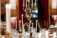 07 Tall and large candelabras decorated with bright blooms and greenery were used as centerpieces