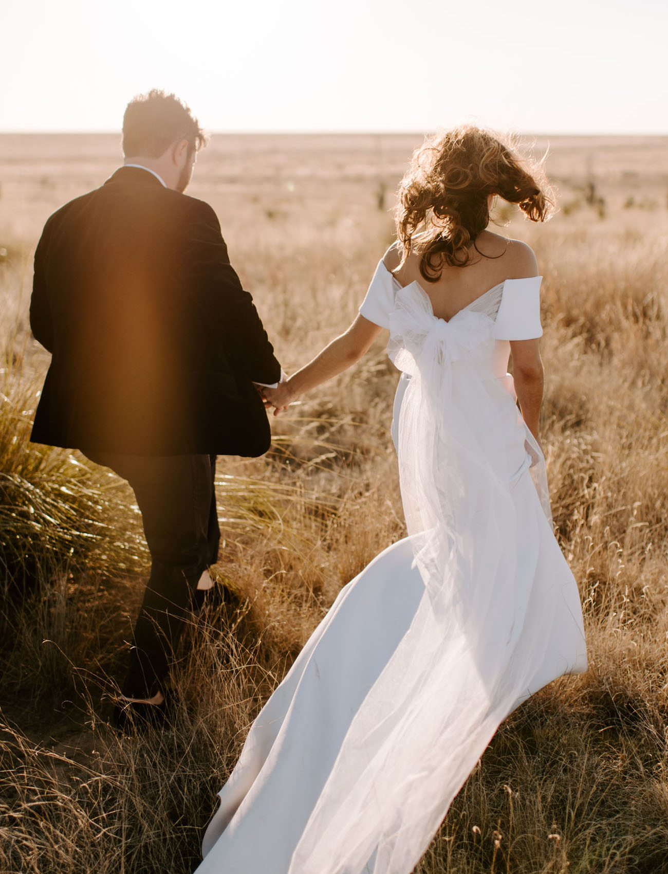 The couple went for a walk and portraits in the desert, look at the gorgeous wedding dress