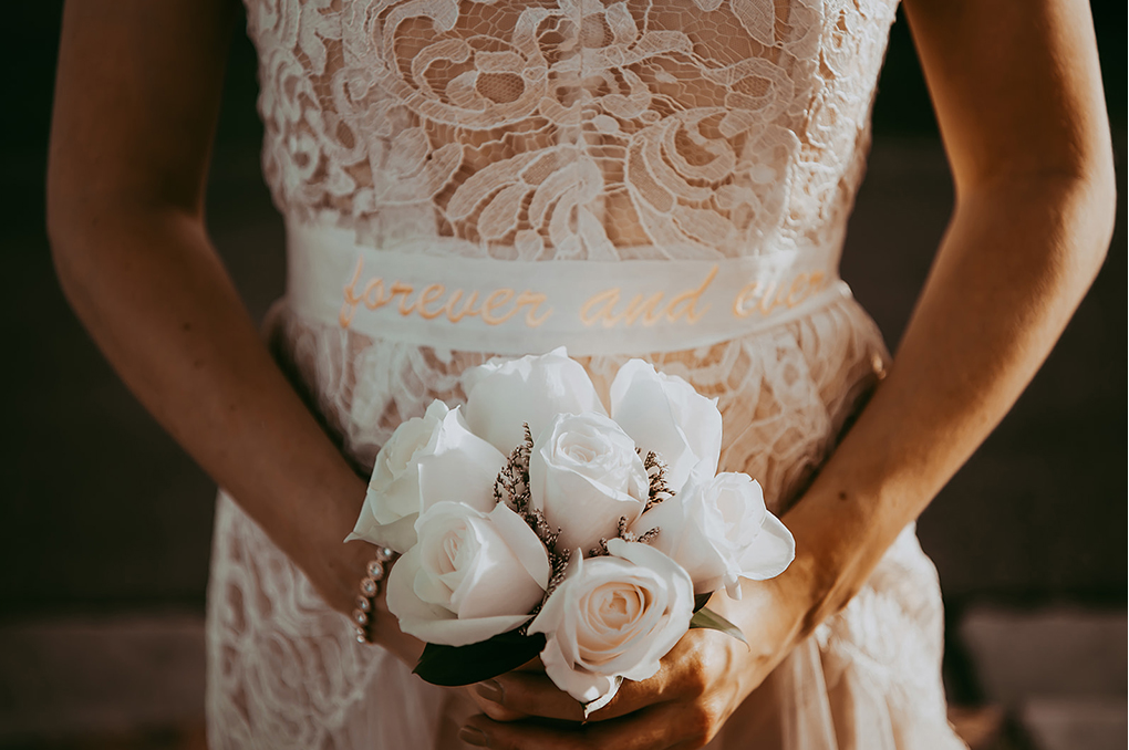 The wedding bouquet was composed of white roses and lavender to make it cuter
