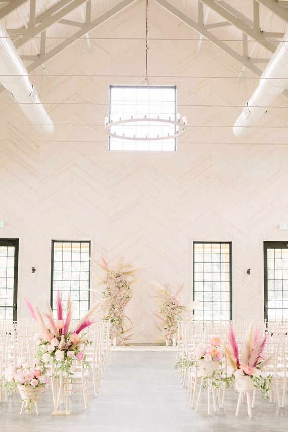 The wedding ceremony space was done with pink and blush blooms, some dried herbs, neutral blooms and greenery