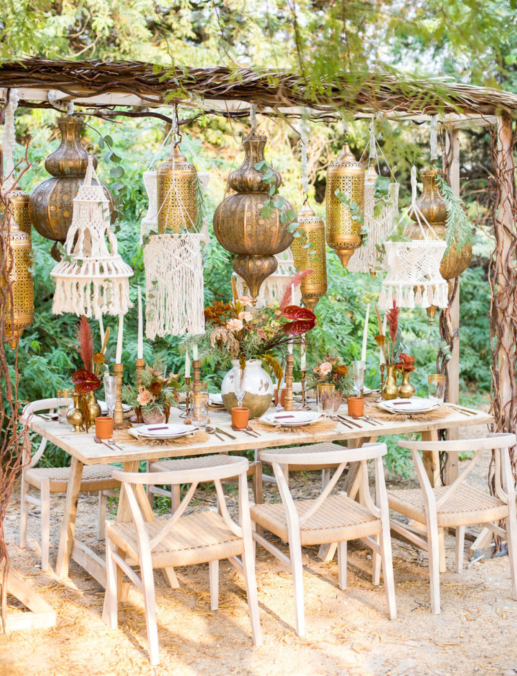 The wedding reception space was done with Moroccan lamps and macrame hangings over the table