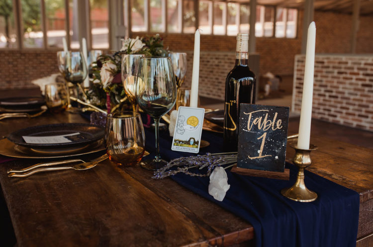 The wedding table was styled with a navy runner, candles, Taro cards, crystals and lavender