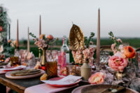 07 The wedding tablescape was done in pink and peachy pinks, with gilded blooms, amber glasses and wooden boards
