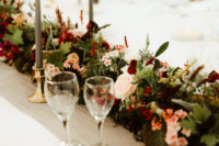 07 The wedding tablescape was done with bright and blush blooms and greenery, with grey candles and neutral tablecloths
