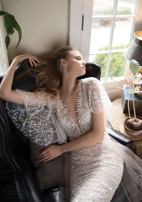 a stunning fully embellished sheath wedding dress with wide short sleeves, a plunging neckline for a sprkly look