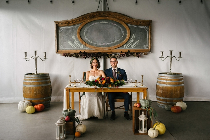Colorful pumpkins, candle lanterns, candleholders and a chalkboard added a cozy rustic fall feel to the space