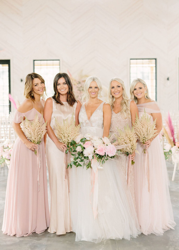 The bridesmaids were wearing mismatching pink and neutral dresses that they chose themselves