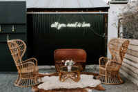 08 The wedding lounge was done with chic rattan furniture, blooms and layered rugs