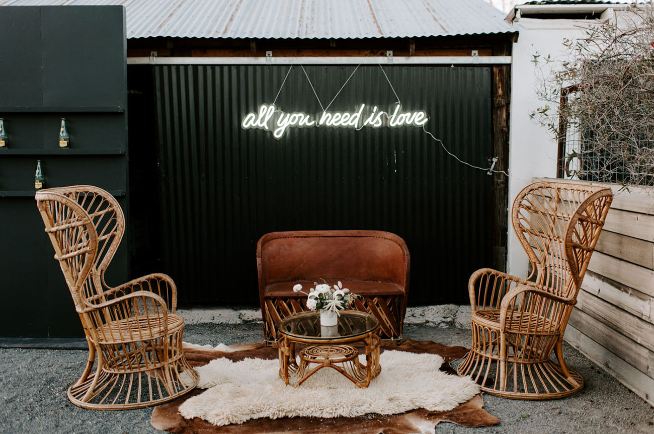 The wedding lounge was done with chic rattan furniture, blooms and layered rugs