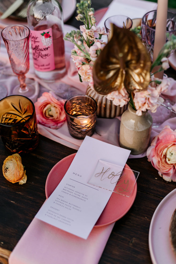 You can also see pink plates, a pink table runner, sheer place cards and simple menus