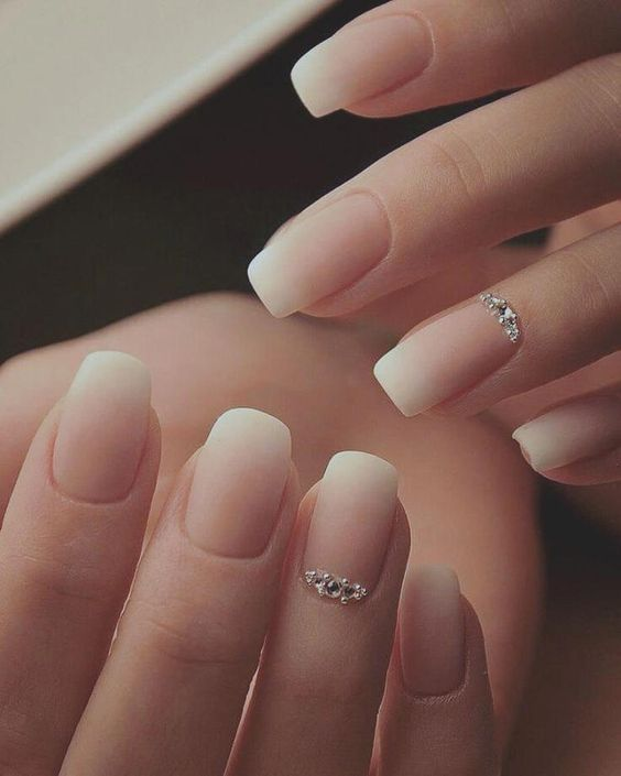an ombre French manicure with shiny rhinestones on ring fingers is a frehs take on the traditional bridal choice