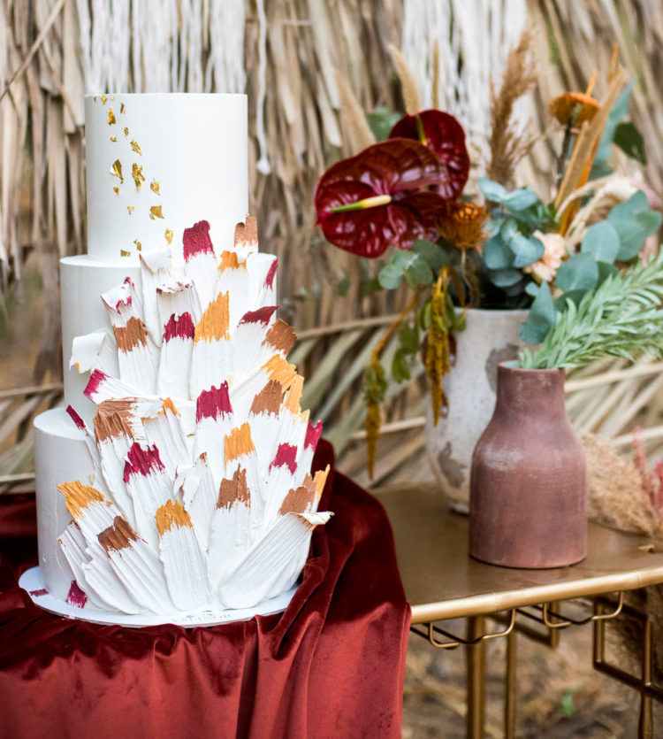 The wedding cake was decorated with colorful brushstrokes
