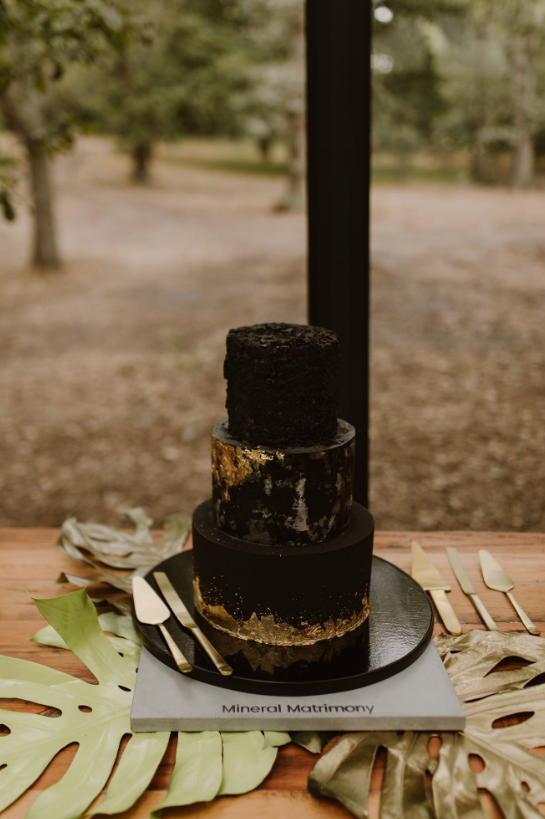 The wedding cake was done in black, with three different tiers and gold leaf