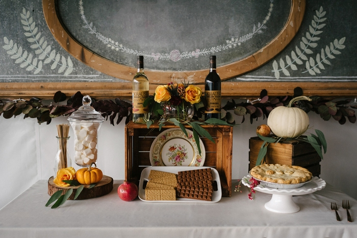 The wedding sweets table showed off s'mores, marshmallows, a cozy fall pie