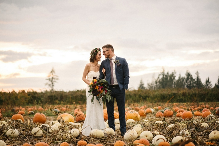 The couple went to a pumpkin field for the wedding portraits