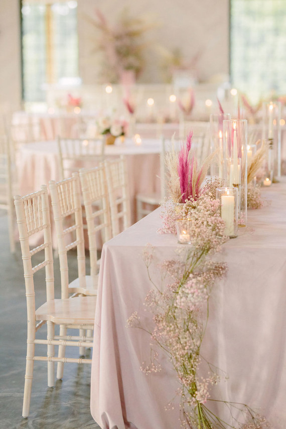 The wedding venue was done in pink and blush, with pretty blooms, candles and herbs