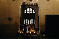 12 The venue was mysterious, lit up and very chic, with skulls, candles and a vintage chandelier