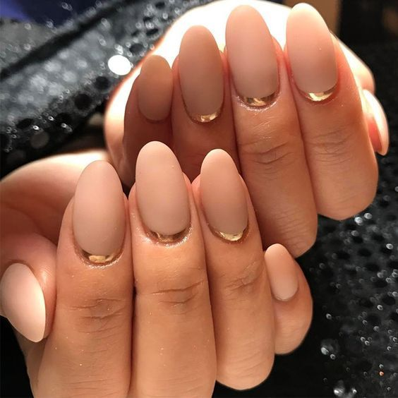 matta neutral nails with gold stickers that will give a shiny and modern feel to your manicure