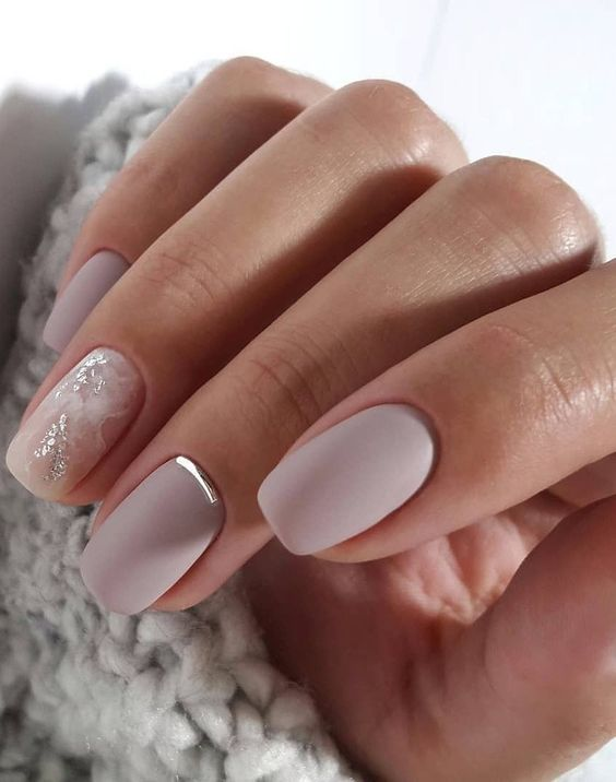 matte lilac nails with a touch of silver and an accent watercolor nail in white and silver for a winter bride