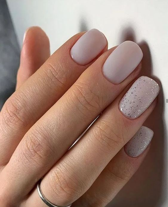 matte white nails and two accent nails done with silver leaf for a slight glam and shiny touch