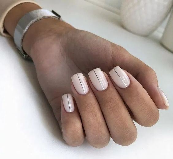 shiny neutral nails with silver vertical stripes are a modern and fresh idea for a bride
