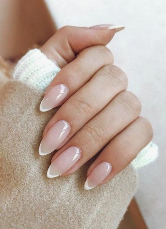 almond nails with a slight French manicure is a chic and stylish idea with a modern feel