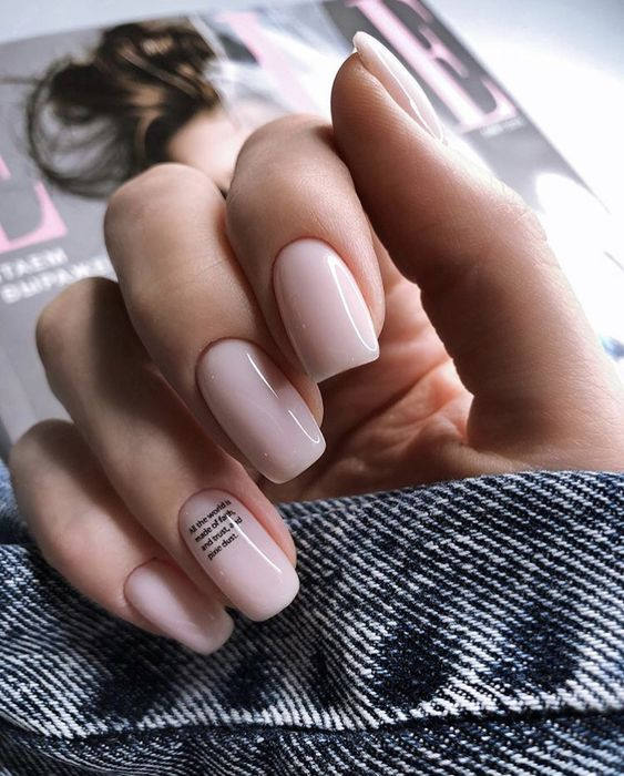blush nails with a tiny quote on the ring finger - choose your favorite quote about love and relationships