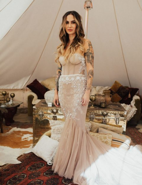 a strapless dusty pink heavily embellished mermaid wedding dress with a train looks spectacular