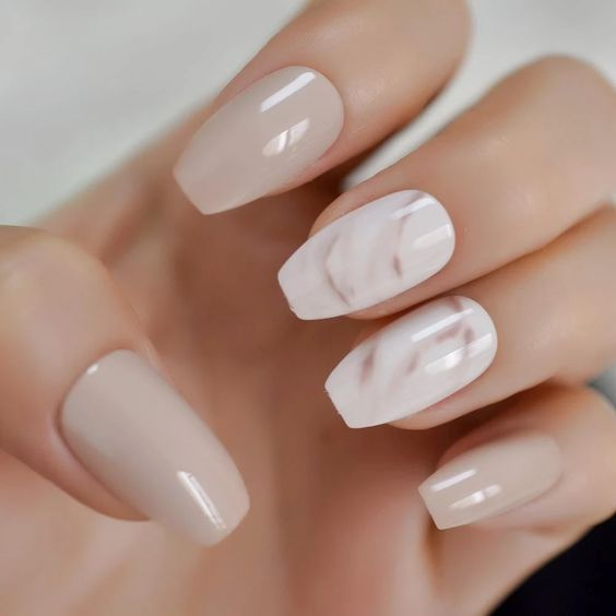 grey and white nails with two watercolor accent ones look very tender and very romantic