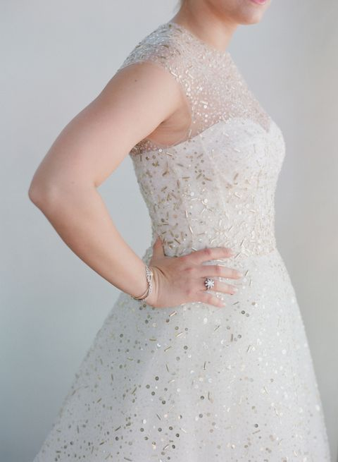 an A-line wedding dress with an illusion neckline, fully covered with embellishments to sparkle