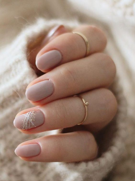 shiny blush wedding manicure and the ring finger accented with white and gold glitter for a winter bride