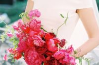 a bold fuchsia wedding bouquet with amaranthus and some textural greenery plus black ribbons