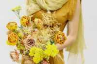 a bold mustard wedding bouquet with fresh and dried blooms and herbs is amazing for a fall bride