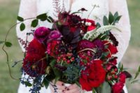 a burgundy wedding bouquet with privet berries, cherries, dark purple touches and textural greenery is a masterpiece
