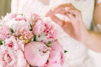 a candy-like pink wedding bouquet of peonies and carnations is a gorgeous idea for a glam bride