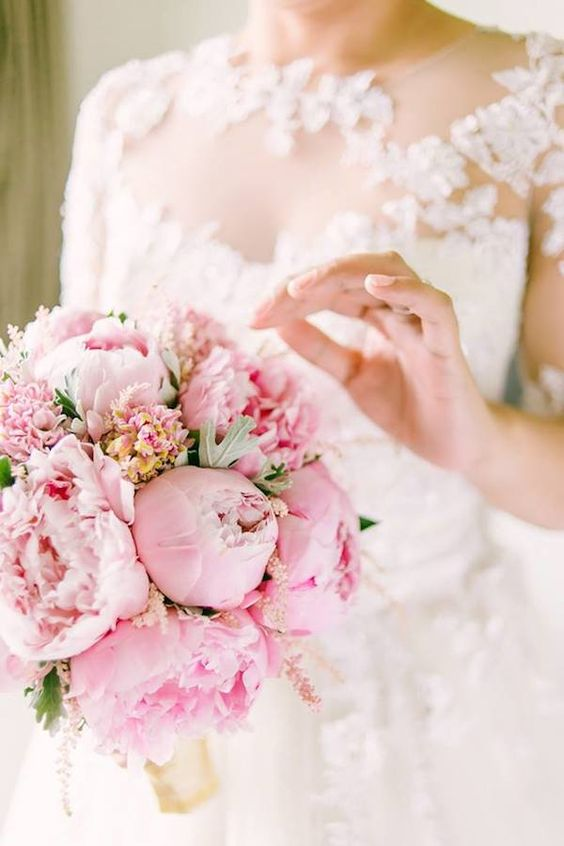 a candy like pink wedding bouquet of peonies and carnations is a gorgeous idea for a glam bride
