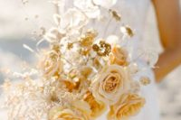 a golden wedding bouquet with marigold and blush blooms, lunaria and some dried herbs for a fall bride