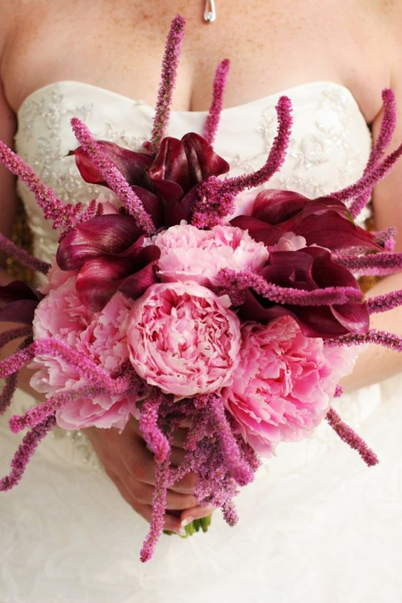 a pink wedding bouquet with deep purples is a very catchy and bold color statement to try