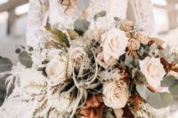 a sophisticated blush wedding bouquet with white touches, pale greenery and air plants for a beach bride