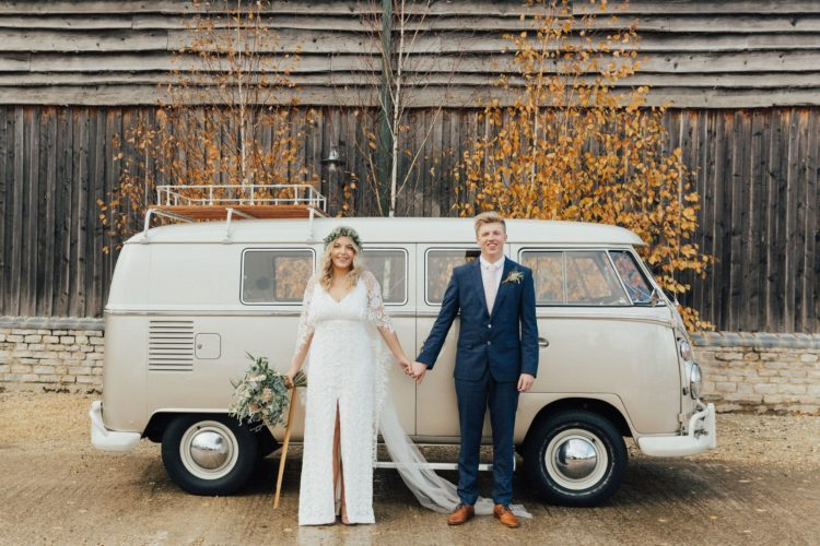 This couple went for a laid back boho fall wedding with lots of greenery and pumpkins