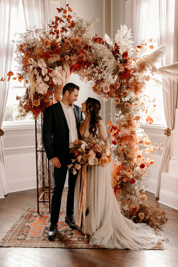 This wedding shoot took place indoors, was done with bright blooms, herbs and foliage and some sparkles