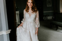 02 The bride was wearing a beautiful and romantic embellished A-line wedding dress with balloon sleeves and an illusion neckline