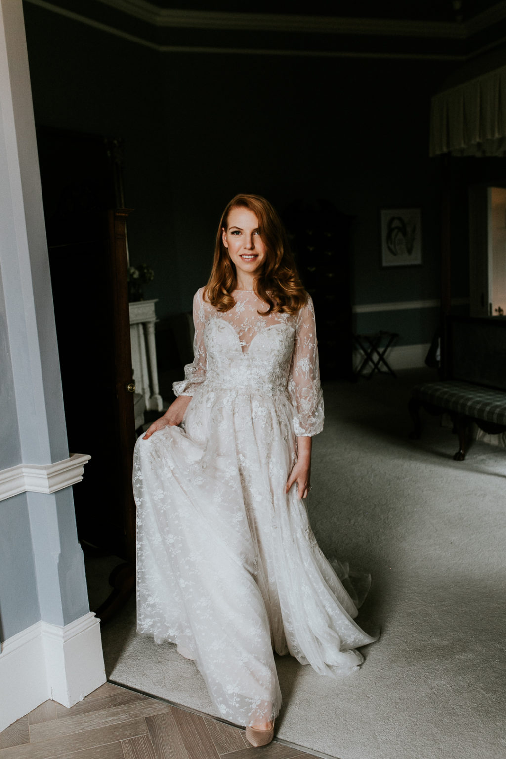 The bride was wearing a beautiful and romantic embellished A line wedding dress with balloon sleeves and an illusion neckline