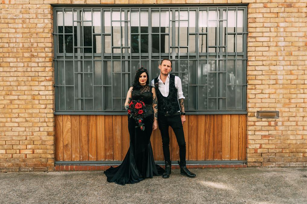 a black mermaid dress is an interesting choice for a bride