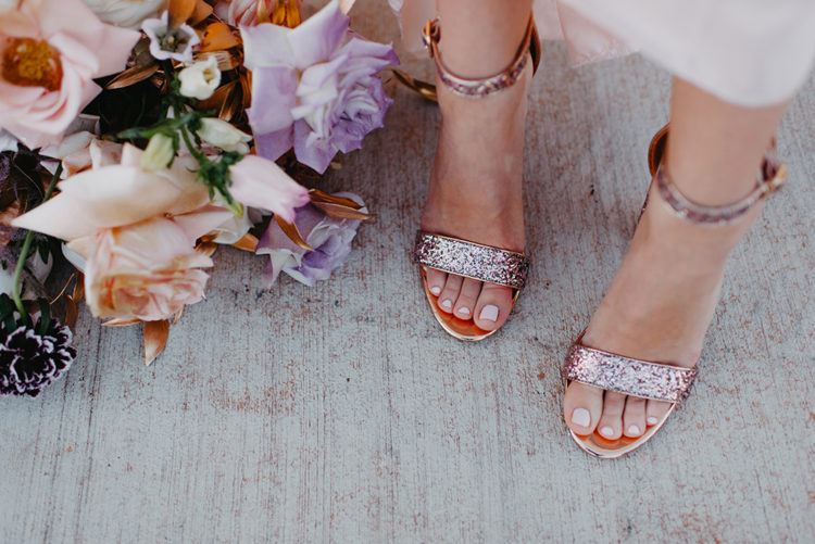 The bride was wearing rose gold glitter wedding shoes