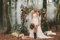 02 The first wedding dress was an off the shoulder one with fringe and an A-line silhouette