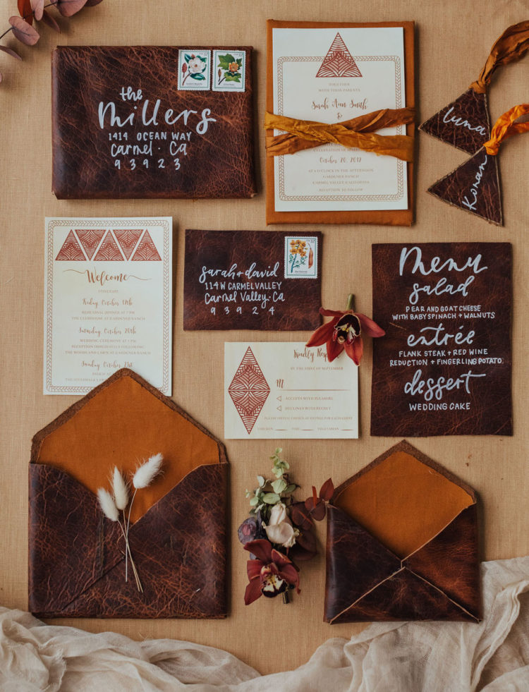 The wedding invitation suite was done with brown leather and amber touches, with velvet ribbons