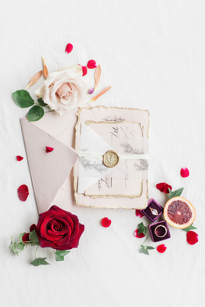 The wedding stationery was done in neutrals and blush, with a raw hem and some vegetation painted