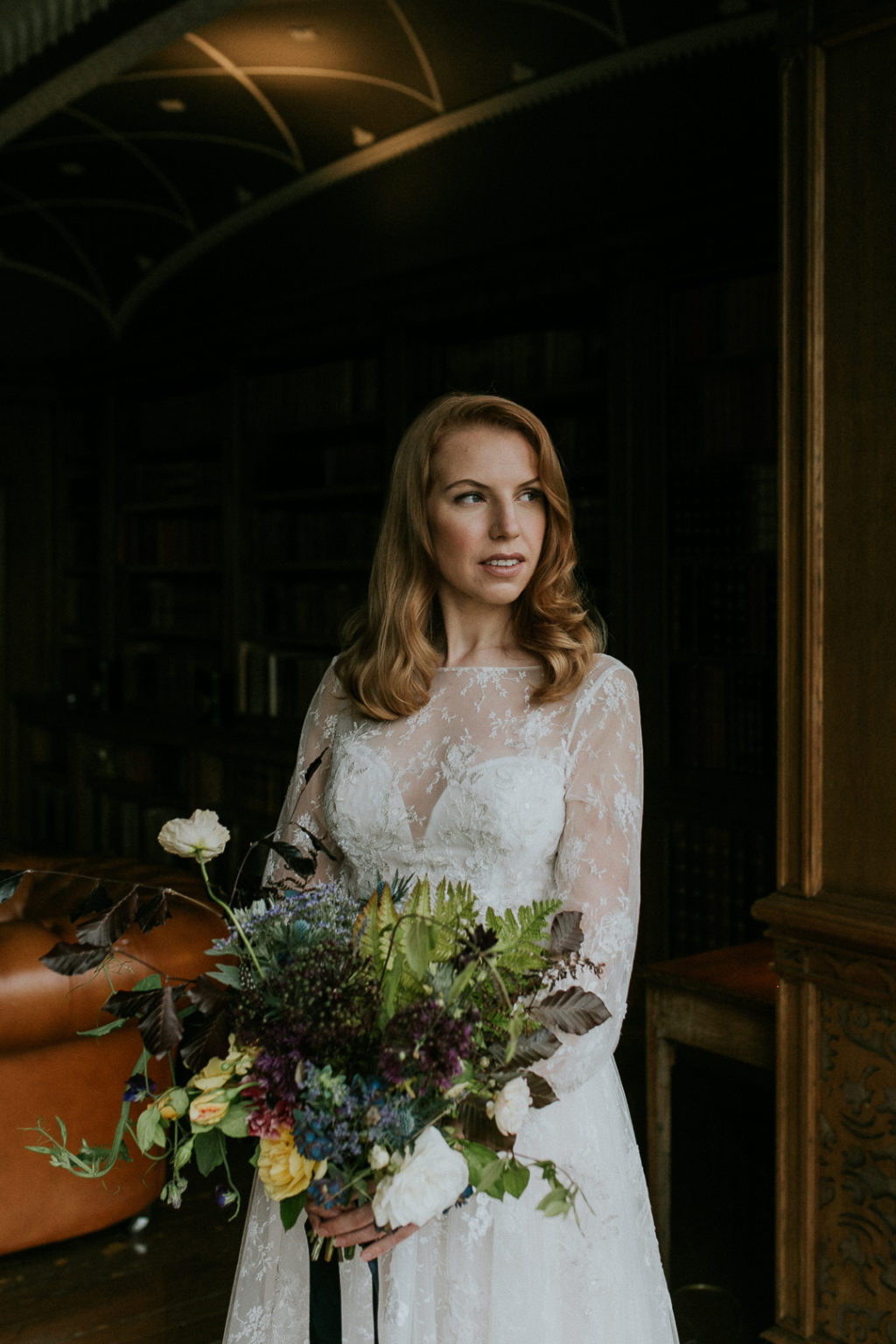 Her wedding bouquet was a lush one, with textural greenery, berries and neutral blooms